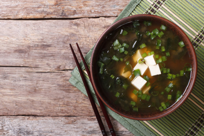 Japanese food - miso soup with tofu on the table